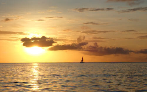 A crewed yacht charter in the Grenadines at sunset