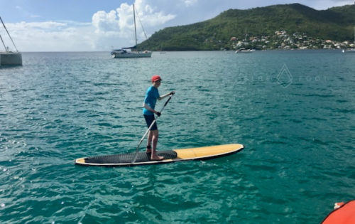 A BlueFoot Travel guest out on the SUP. Big smiles.