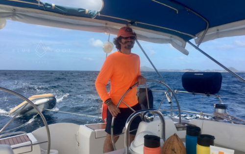 One of BlueFoot Travel's guests enjoying time at Nemo's helm