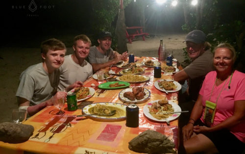 Yum yum yum! BlueFoot Travel guests enjoying a beach BBQ in Tobago Cays.