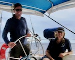 Neil and Sam, writers of NauticEd's Yacht Charter Crew course on board their sailing yacht Nemo in the Caribbean.