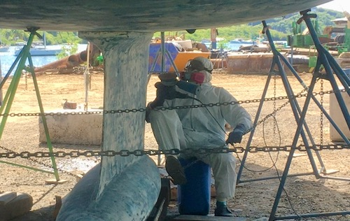 Neil sat underneath Nemo in Clarkes Court Boat Yard getting ready to sand the antifouling paint off