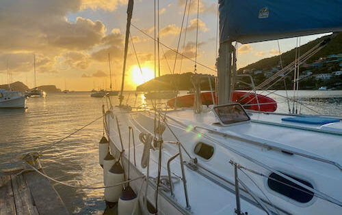 Nemo on the dock in Bequia as the sun sets