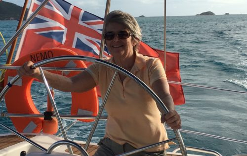 BlueFoot Travel guest at helm under care of skipper Neil sailing around Antigua & Barbuda