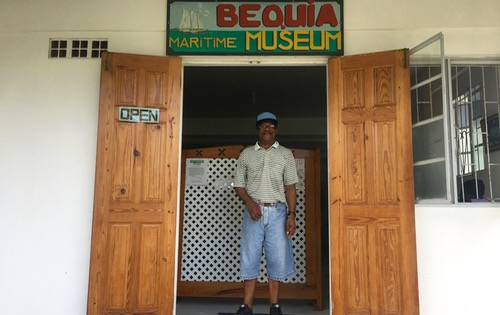 Lawson Sergeant posing for BlueFoot Travel in front of his Maritime Museum in Bequia
