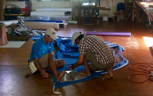 The Grenadines Sail & Canvas team replacing SY Nemo's sprayhood windows.