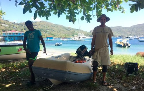 The Grenada Sails & Canvas team working their magic on BlueFoot Travel's TT SY Nemo...aka Dorey the Dinghy
