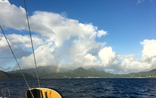 BlueFoot Travel arriving in Prince Rupert Bay, Dominica with a stunning rainbow.