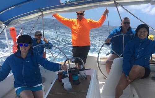 Guests all decked out in their Gill wet weather jackets as a squall passes by along the coast of Guadeloupe