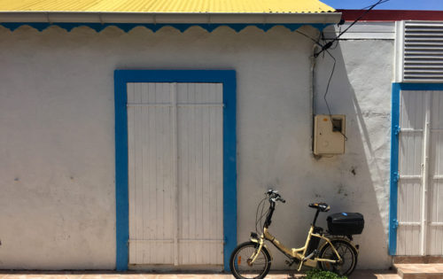 A bike leaning up against a wall in Terre de Haut, Guadeluope