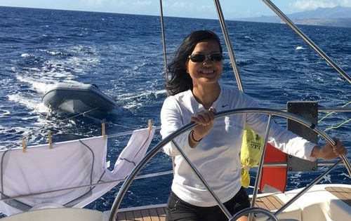 A huge smile as one of our guests on board Nemo takes the helm as we sail along the coast of Martinique