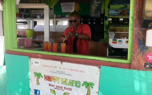 Mr King making us rum punch cocktails at Happy Island in St Vincent & The Grenadines