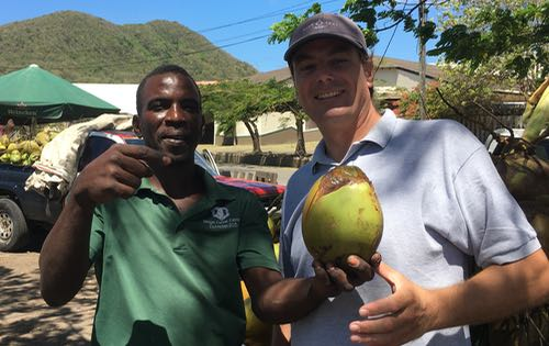 Neil, from BlueFoot Travel, with Trevor, a coconut farmer, getting ready to taste the lovely coconut water