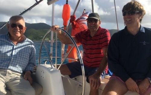 BlueFoot Travel guest on the helm as we sail around Antigua & Barbuda