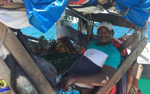 The wonderful local grocer, delivering fresh vegetables to us on Nemo in Rodney Bay, St Lucia