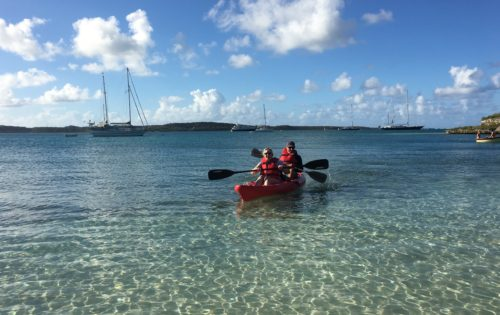 Happy BlueFoot Travel guests on their own private beach on Green Island Antigua